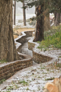 The Nieu Bethesda water furrows are dry in the snowfalls.