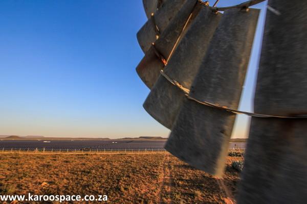 Karoo solar energy photographed from the platform of a  Karoo windpump.