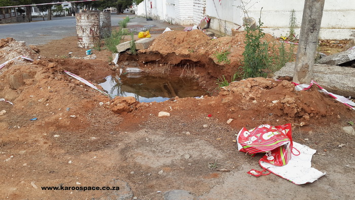 As if the never-fixed water pipe repairs were not enough, rubbish began to gather in and around the watery pit.