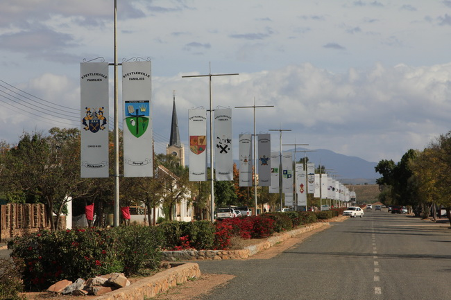 The family crests of locals line the main street of Steytlerville, Eastern Cape.