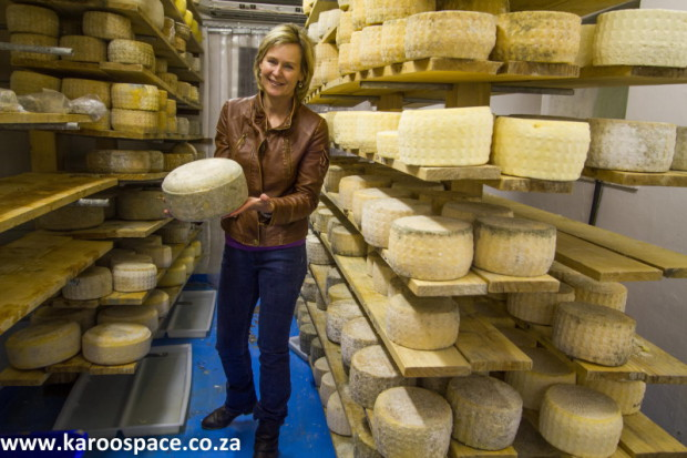 Francy in the coolroom, where the cheeses slowly mature.