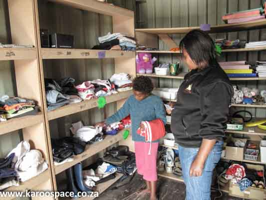 Volunteers help the children with their 'purchases'.