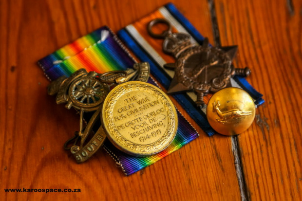 Medals, badges and buttons from the little wooden box.