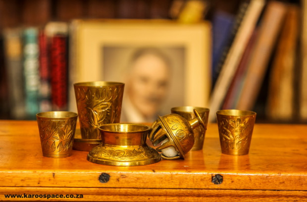 He acquired a few brass cups, bowls and a bell.